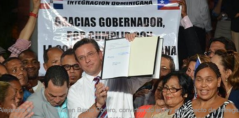 Gov. García Padilla celebrates with Dominican community new law he enacted that allows undocumented immigrants the right to test for driving licenses.